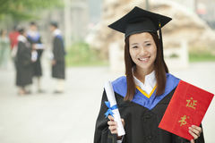 Happy Graduate with Diploma Stock Photos