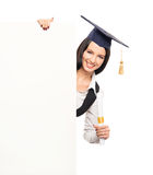A happy graduate girl student with a white banner Royalty Free Stock Images