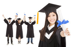 Happy  graduate girl and  students Stock Images