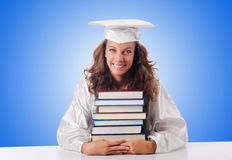 Happy graduate with lots of books on white Stock Photography