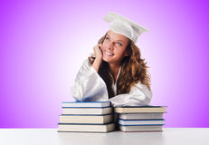 The happy graduate with lots of books on white Stock Images