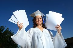 Happy graduate with papers. Young graduate woman with blank papers Stock Image