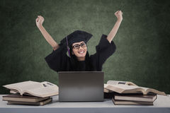 Happy graduate raised arms with blank board Stock Photography