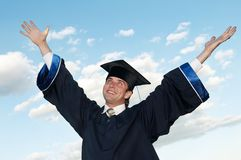Happy graduate with risen arms Royalty Free Stock Photography