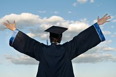 Happy graduate with risen arms Stock Photography
