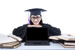 Happy graduate student with copyspace on laptop Stock Photos