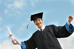 Happy graduate student in gown Royalty Free Stock Images