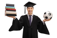 Happy graduate student holding stack of books and football Royalty Free Stock Image
