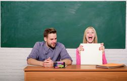 Happy graduate. Student life. Lesson and blackboard. Teachers day. Back to school. Modern school. Knowledge day. Couple. Of man and woman in classroom. Home royalty free stock photo