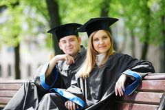 Happy graduate students outdoors Royalty Free Stock Photos