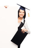 Happy graduate woman with a white banner and a folder Stock Photography