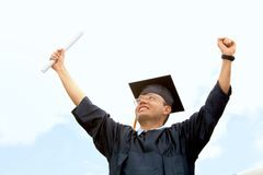 Happy graduated man Stock Photo