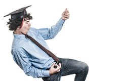 Happy graduated student. Happy student, dancing and playing imaginary guitar, on white background Royalty Free Stock Photography