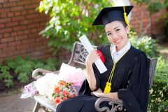 Happy graduated student girl hold certificate - congratulations. Of education success stock photos