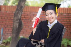 Happy graduated student girl hold certificate - congratulations. Of education success stock images