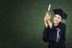 Happy graduated student girl with scroll Royalty Free Stock Photos