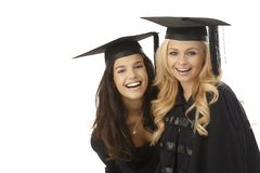 Happy graduates in graduation cap Royalty Free Stock Images