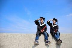 Happy graduates student look sky Stock Photos