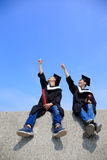 Happy graduates student look sky Royalty Free Stock Photography