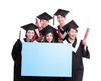 Happy graduates student show billboard Royalty Free Stock Photography
