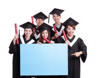 Happy graduates student show billboard. Group of happy graduates student show blank billboard isolated on white background, asian royalty free stock image