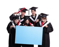 Happy graduates student show billboard Royalty Free Stock Photos