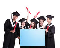 Happy graduates student show billboard Stock Images