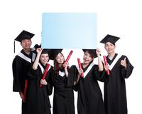 Happy graduates student show billboard Royalty Free Stock Photos