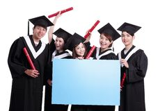 Happy graduates student show billboard Royalty Free Stock Photo