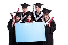 Happy graduates student show billboard Royalty Free Stock Photo