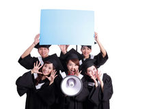 Happy graduates student show billboard Stock Photo