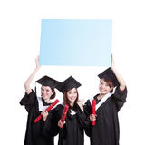 Happy graduates student show billboard Stock Photography