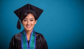 Happy graduating Asian student closeup over blue royalty free stock photo
