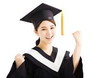 Happy graduating asian student raise hand with success gesture stock photos