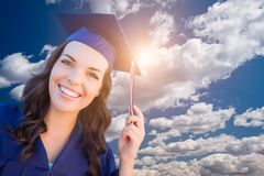 Happy Graduating Mixed Race Woman In Cap and Gown Stock Photo