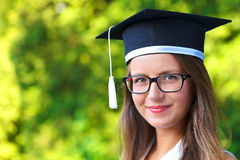 Happy graduating student royalty free stock photo
