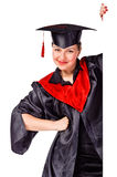 Happy graduating woman holding a display for text Stock Images