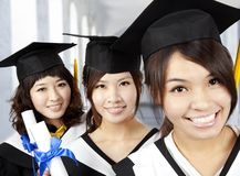 Happy graduation asian girls. In the school royalty free stock photos