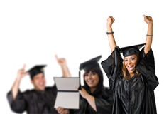 Happy Graduation Day. A group of high school or college graduates cheering happily on graduation day. Shallow depth of field Royalty Free Stock Images