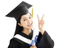 Graduation girl In Cap and Gown Celebrating royalty free stock image