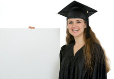 Happy graduation student holding blank billboard Stock Image