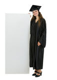 Happy graduation student holding blank billboard Stock Images