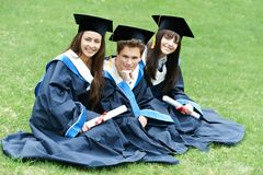 Happy graduation students royalty free stock images