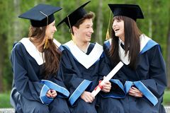 Happy graduation students royalty free stock photography