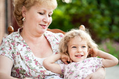 Happy grandchild with grandmother Stock Photography