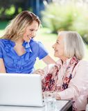 Happy Granddaughter And Grandmother With Laptop On Stock Photo