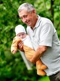 Happy grandfather Stock Image