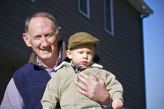 Happy grandfather. Holding cute grandson outside Stock Image