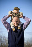 Happy grandfather. Holding cute grandson outside Royalty Free Stock Photography