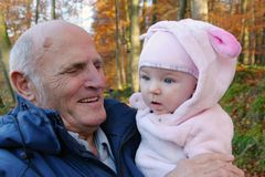 Happy grandfather with baby granddaughter outdoors Stock Photography